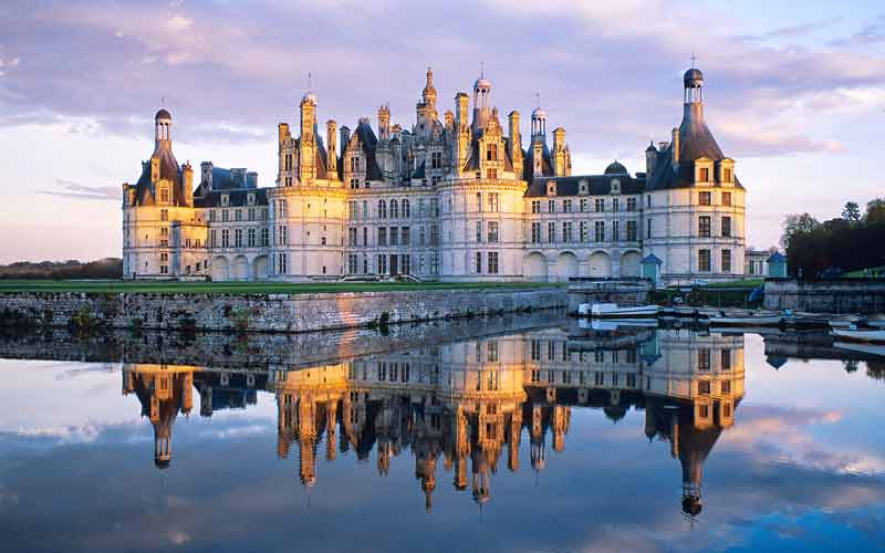 turrets and towers at twilight at the Chateau de Chambord, Loire Valley