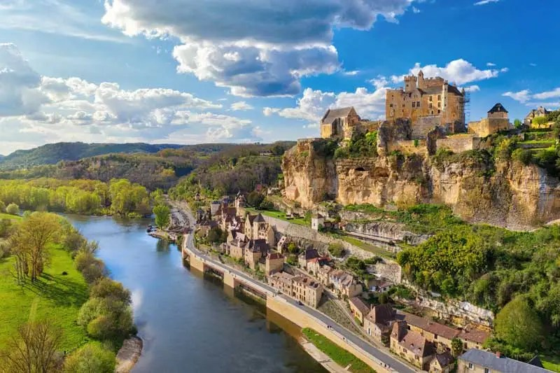 Castle of Beynac atop a hill overlooking the river Dordogne