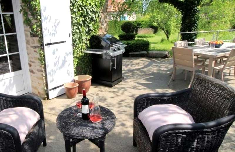 Garden with a barbecue and chairs and table perfect for relaxing