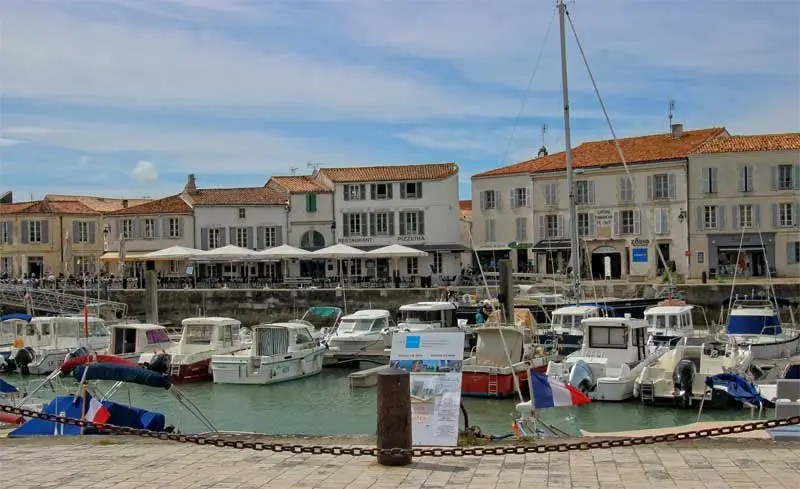 Quayside lined with pretty shops and houses at Saint-Martin on Ile de Re France
