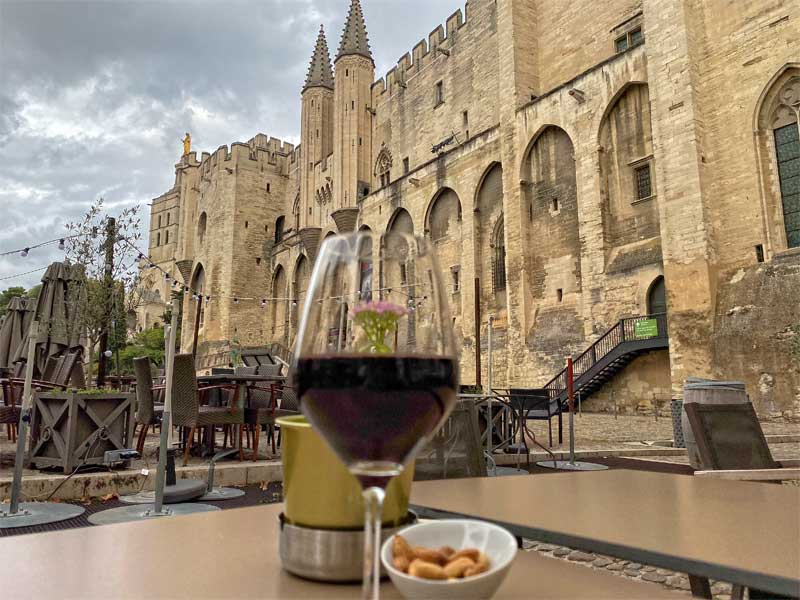 Glass of wine at a wine bar in Avignon in the courtyard of the Papal Palace