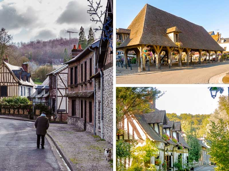 Man walking a dog along a pretty street of half timbered houses in Lyons-la-Foret