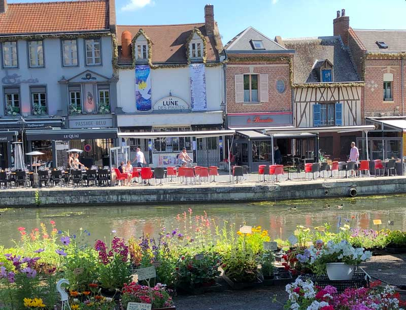 Canal lined with market stalls in Amiens