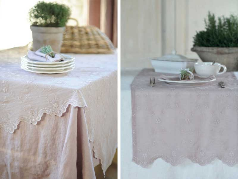 Table with pink and white table cloths and plants in a bowl