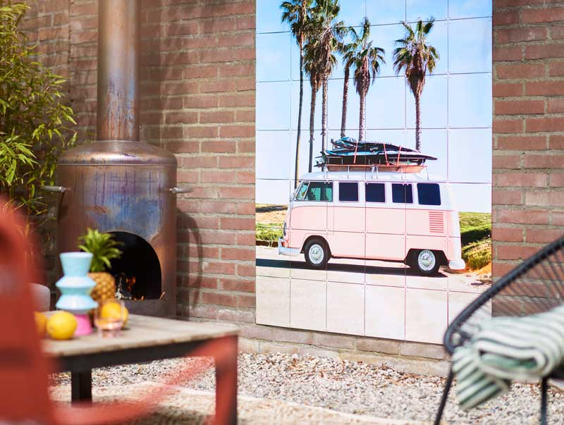 Outdoor room with artwork showing a touring van on wall