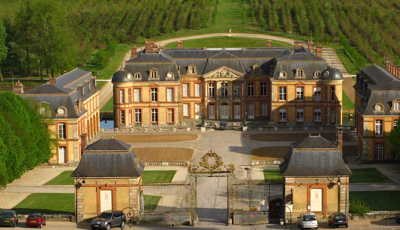 Monumenatal Chateau of Dampierre with slate roof surrounded by vineyards