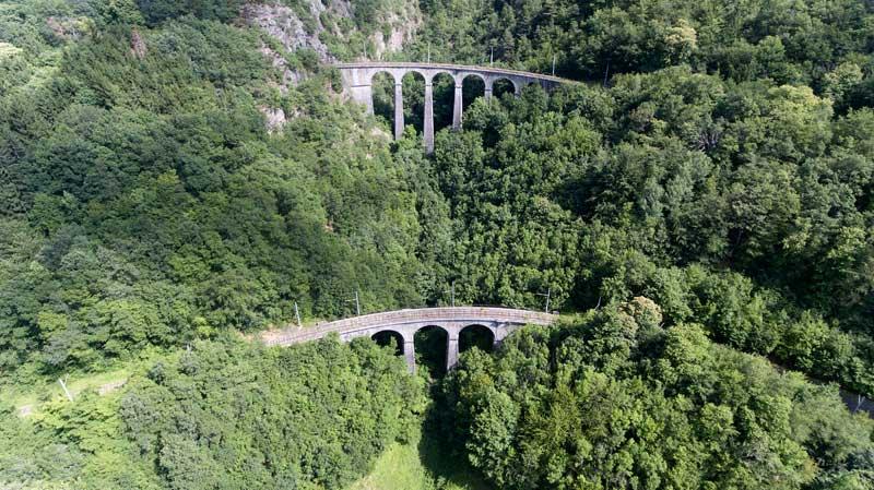 Narrow railway track running through steep mountains in La Mure, Isere