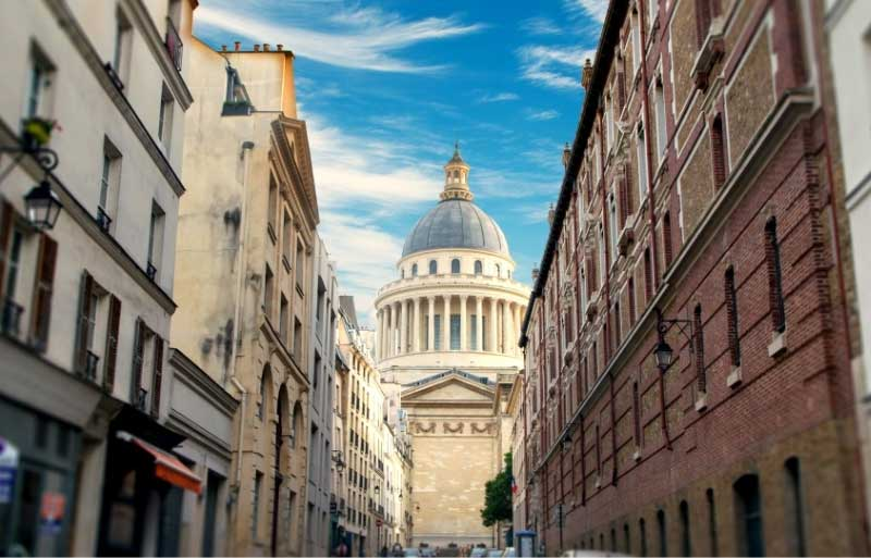 View of the Pantheon Paris seen from a side street its domed top looming over local buildings