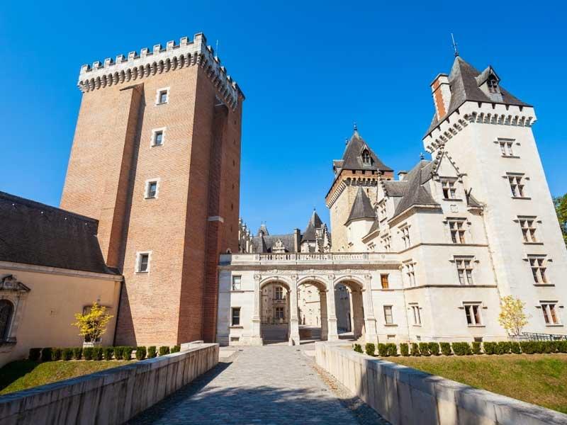 Pau Castle, tall towers and turrets against a deep blue sky
