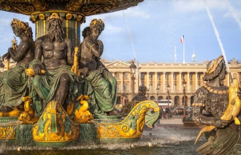 Beautiful fountain in a grand square in front of the Hotel de La Marine, Paris