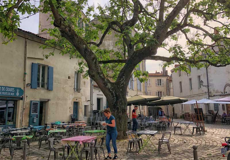 Small cobbled square lined with pretty bars and restaurants in La Rochelle