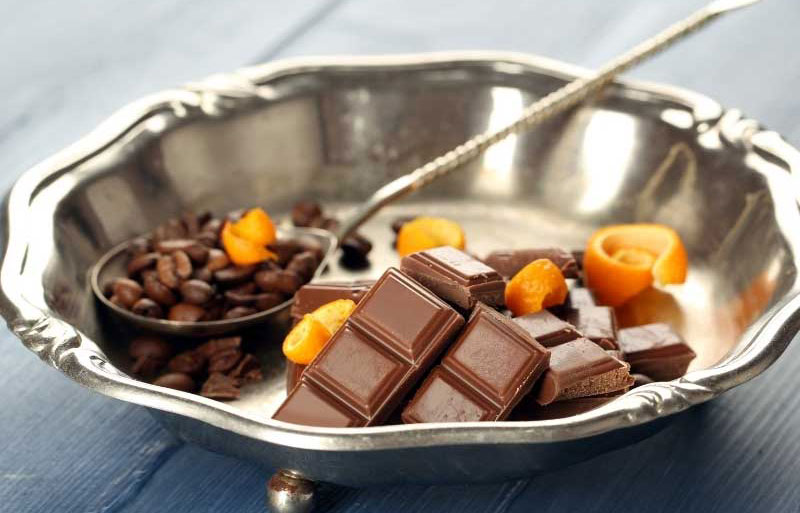 Coffee beans, chocolate and orange, ingredients for Liqueur 44