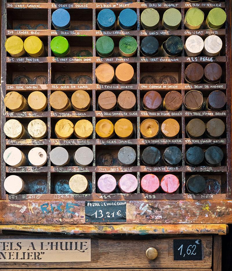 Pastels for drawing in an antique wooden shelf unit, Maison Sennelier