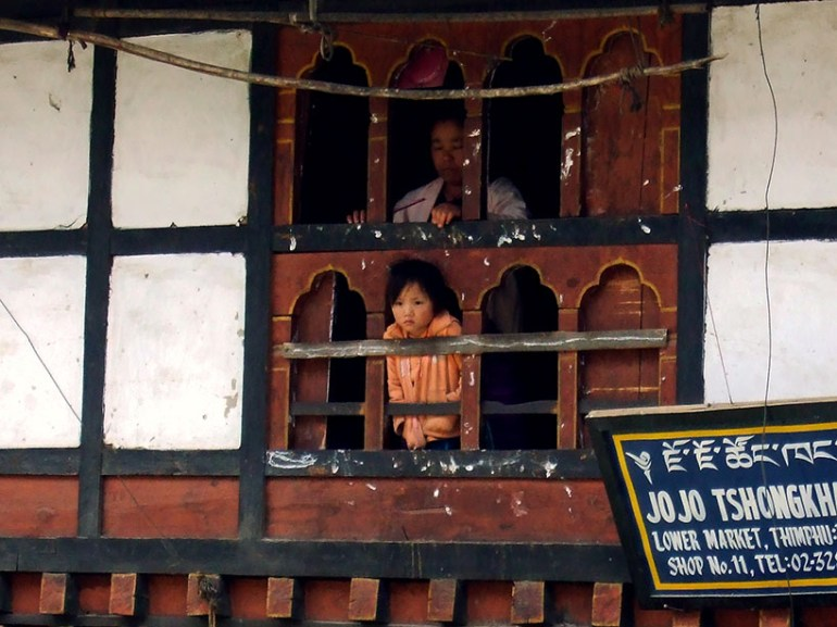 Bhutan - Girl in the window