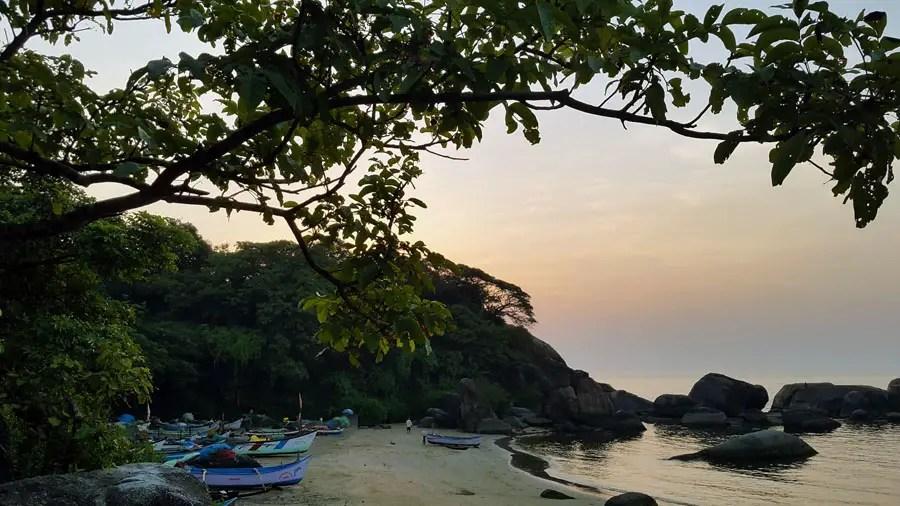 Fishing boats and rocks at sunset at Agonda, Goa, India - perfect base for a Goa trip