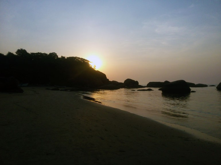 Sunset behind the rocks at Agonda beach, Goa, India- perfect for a Goa trip
