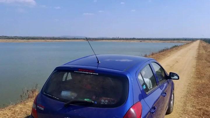Road trips from Hyderabad - Driving over the dam at the Sarpanpally lake, Ananthagiri Hills, Vikarabad, India