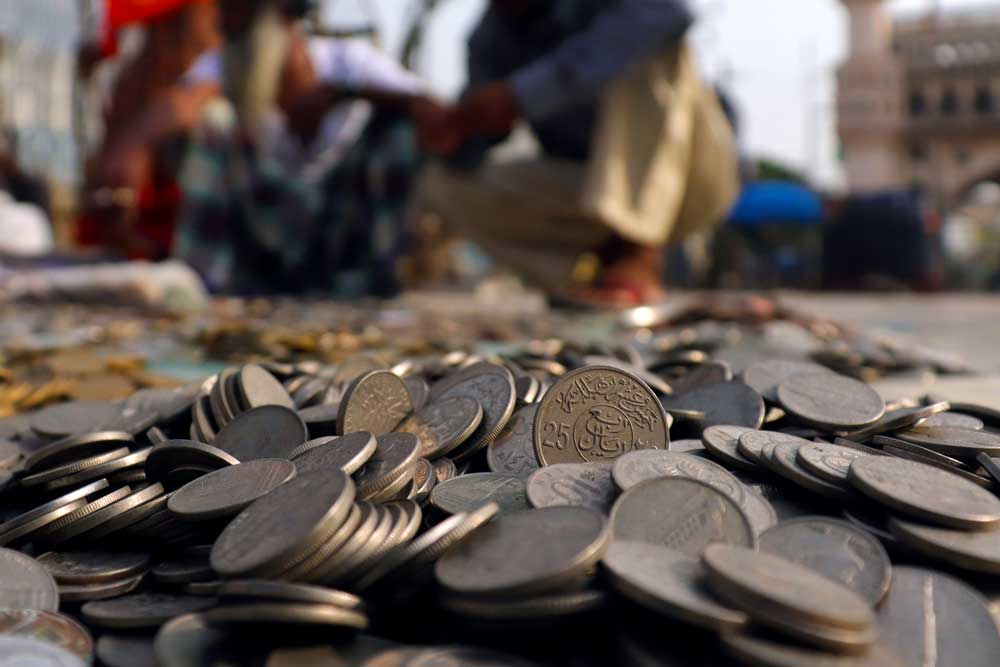 Antique coins on sale by the roadside behind Charminar in the morning - the best time to visit Charminar