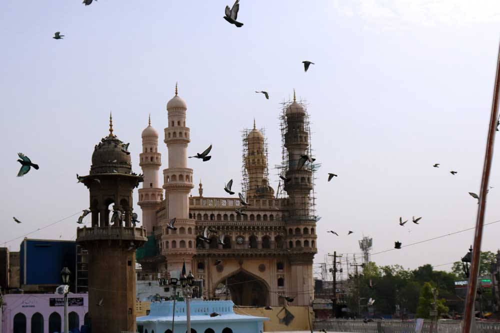 Pigeons and Charminar seen from Mecca Masjid