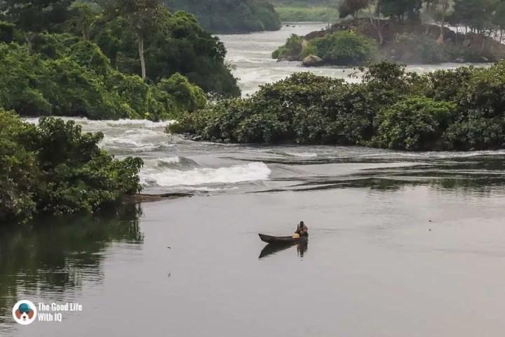 Fishing boat and river rapids, Jinja, Uganda
