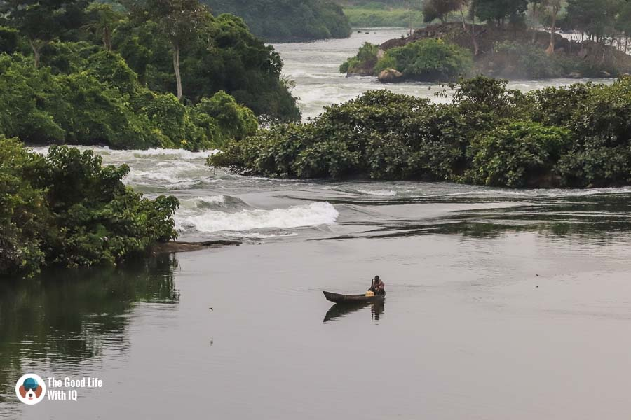 Fishing boat and river rapids, Jinja, Uganda