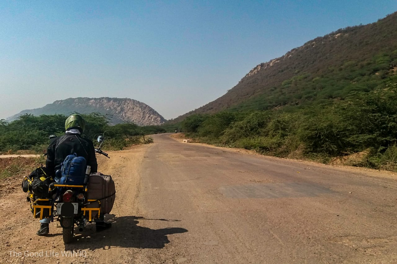 Biker and bumpy road, Rajasthan