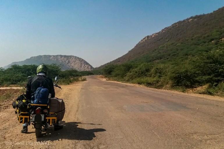 Biker and bumpy road, Rajasthan