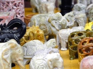 Miniature carved elephants jostle for attention