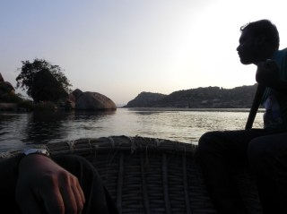 An evening coracle boat ride on the Sanapur reservoir