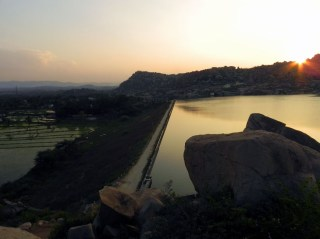 The main dam of the Sanapur reservoir at sunset