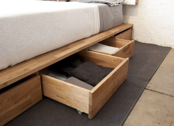 A bed frame with drawers.