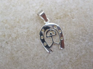 Horseshoe jewelry with Indalo charm