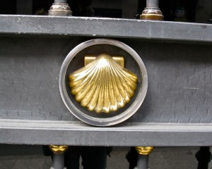 Golden scallop shell on church