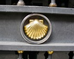 Golden scallop shell on church