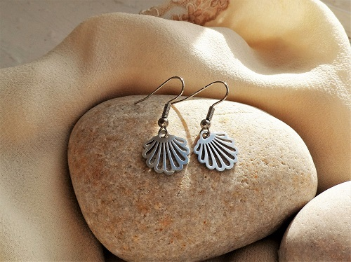 Scallop shell earrings wish success to someone starting new journey