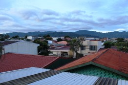 Looking through the bars of our small balcony, we spend time with Lord, the mountains, and the rooftops each morning.