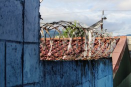 Theft is serious business in Central America. Razor wire, wrought iron, concrete walls, and big locks help to keep our home safe.