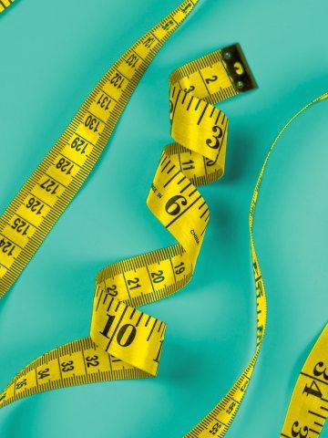 Yellow flexible measuring tape.