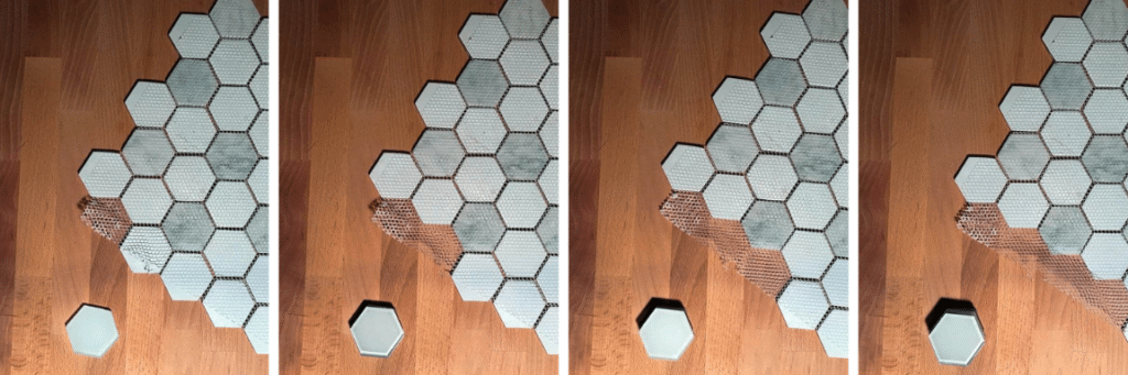 Removing the marble tiles from the mesh backing.