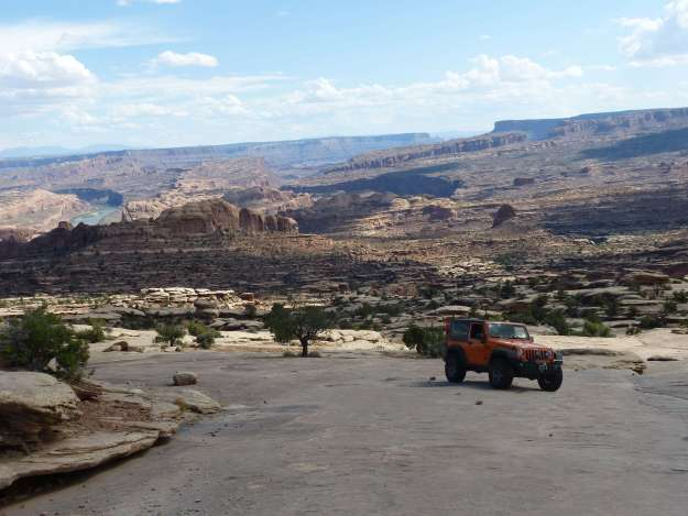 jeep and view of canyonlands,UT from 4x4 trail Golden Spike