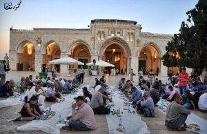 Muslims having Iftar at the compound of al-Aqsa Mosque, Palestine.