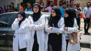 Medics attending the funeral of their colleague, Razan.