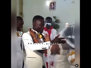 VIDEO: 'You May Kiss The Bride' Turns 'War' In Church As Couple Struggles To Kiss In The Presence Of A Congregation