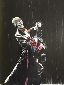 Joker dancing with empty bat suit