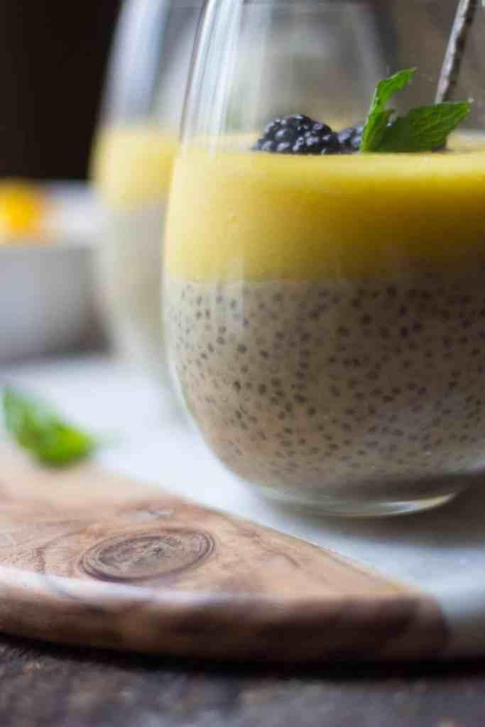 Mango vanilla pudding in clear glasses