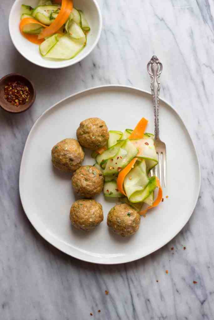 Finished overhead shot of Asian-Style Pork Meatballs with Sesame Cucumber Salad