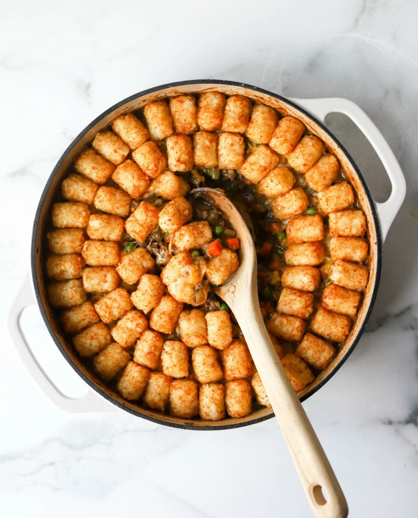 Tater tot casserole in white dish (an example of a healthy one pot meal)