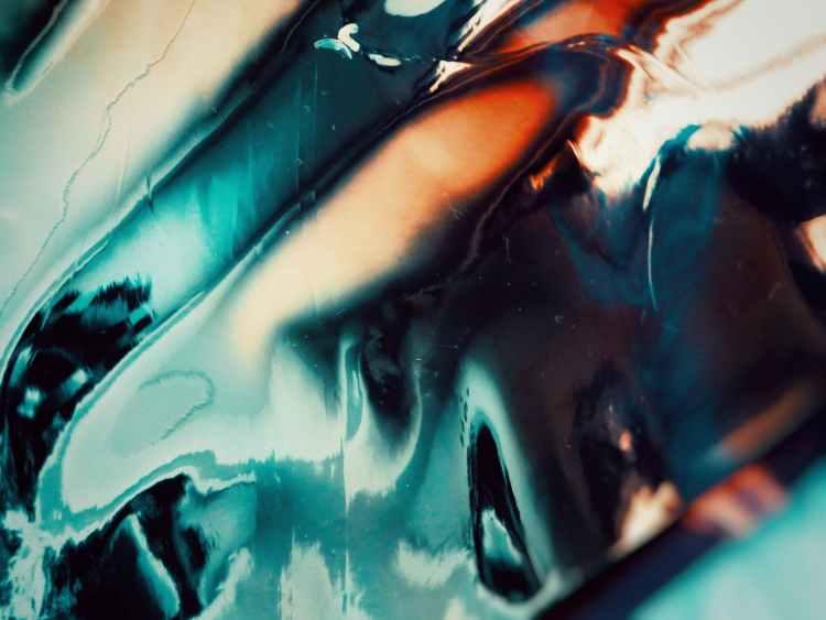 close up photo of blue liquid