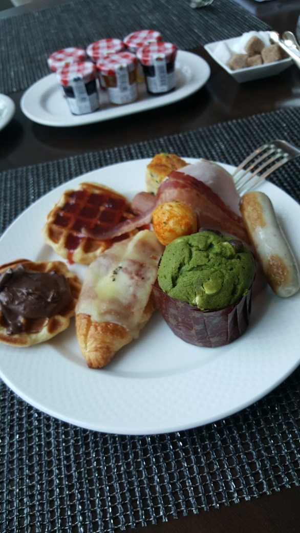 Matcha muffin, cheese croissants, waffles with nutella and strawberry spread