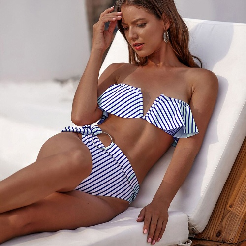 Girl lounging in striped high rise two piece swimsuit